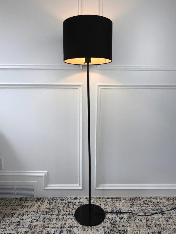 black ikea floor lamp on