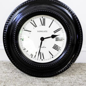 Decorative large black wall clock staging