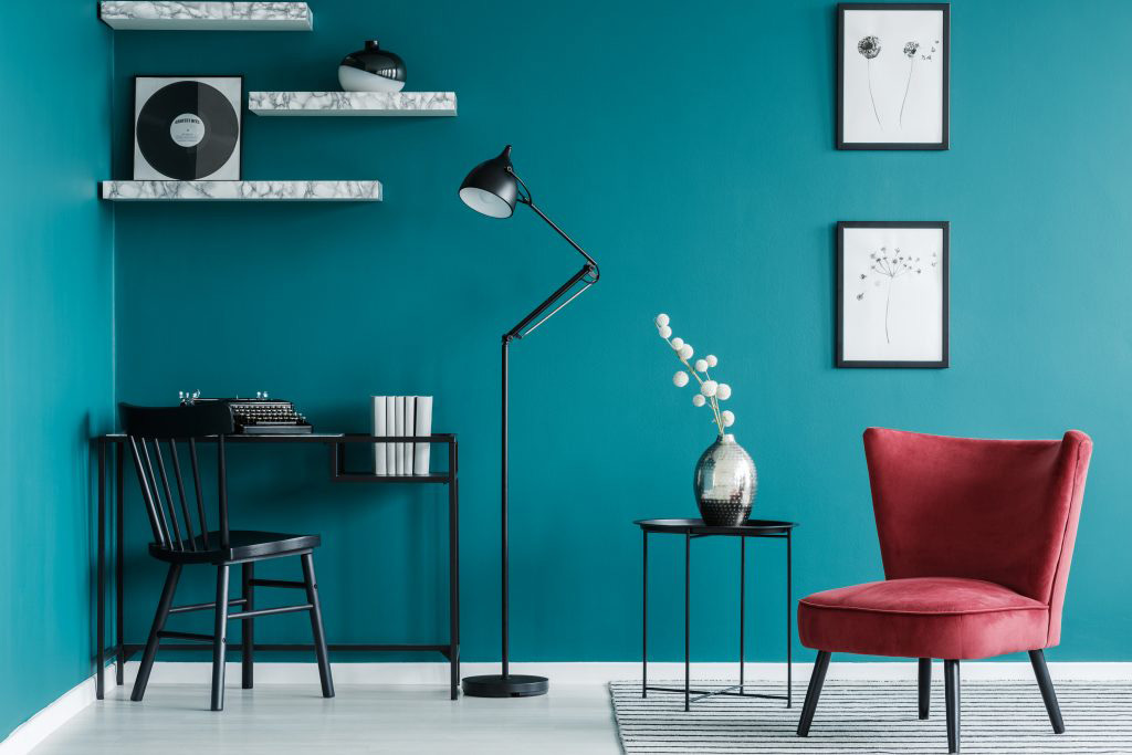 Creative Turquoise Home Office with red accent chair