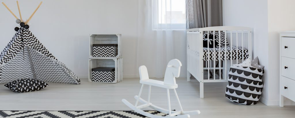 White and black children room with tipi tent, cradle and rocking horse