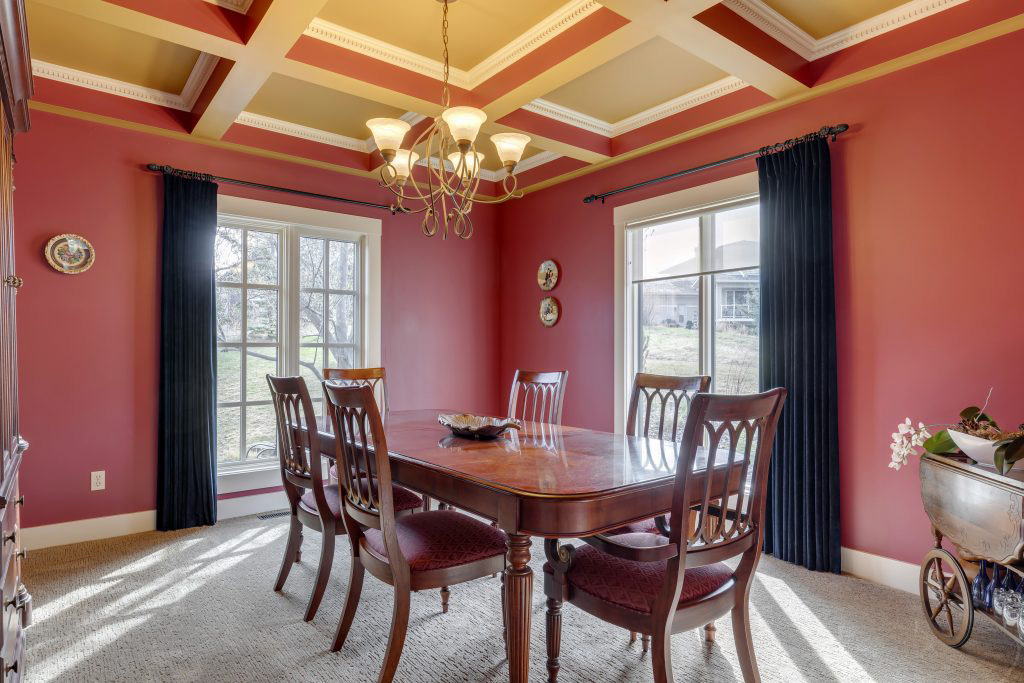 Red traditional dining room with dark wood furniture