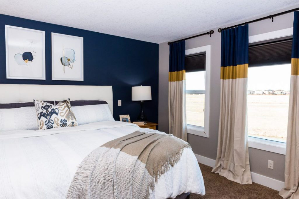 Gold and navy blue colour palette bedroom