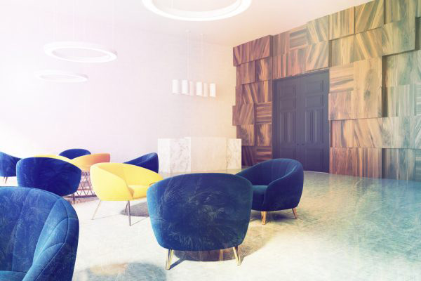 An office lobby in blue and yellow tones for a complementary colour scheme